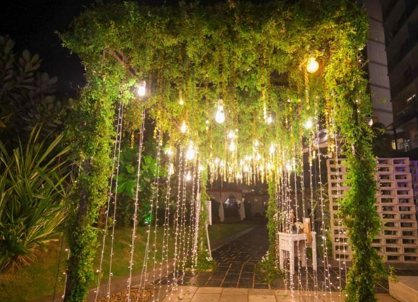 Wedding entrances done in heavy foliage and floral arrangements and further lit up with bulbs
